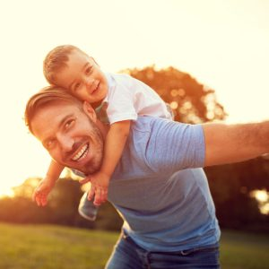 father and son happy about affordable family dentistry
