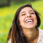 Bright smile of patient with periodontal disease in current remission