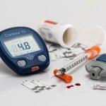 Image of diabetic supplies. Learning to live healthier can help you better manage your diabetes and is an Excellent New Year's Resolution.