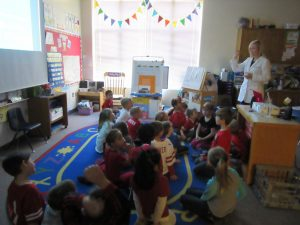 Image of a children's dentist in Lincoln, NE presenting to a class of children.
