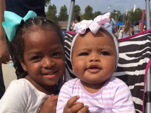 Image of two happy kids at the health fair in Lincoln, NE.