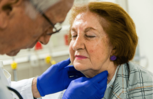doctor helping an elderly woman with oral hygiene dental care for seniors in Lincoln, NE