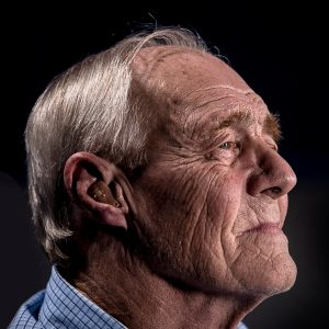 Elderly man with bad breath looking for about dental care for geriatric patients in Lincoln, NE