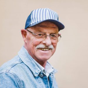 Mature man in cap looking for dental care for geriatric patients in Lincoln, NE