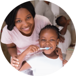 Lincoln Dentist for Children scenario of child brushing teeth with family