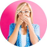 Image of a woman who is covering her mouth because of bad breath.