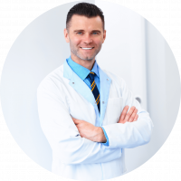 Image of a dental professional who is ready to perform a